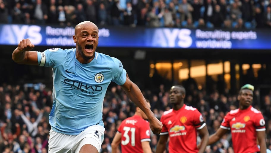 Manchester City's Belgian defender Vincent Kompany (L) celebrates scoring the opening goal during the English Premier League football match between Manchester City and Manchester United at the Etihad Stadium in Manchester, north west England, on April 7, 2018. / AFP PHOTO / Ben STANSALL / RESTRICTED TO EDITORIAL USE. No use with unauthorized audio, video, data, fixture lists, club/league logos or 'live' services. Online in-match use limited to 75 images, no video emulation. No use in betting, games or single club/league/player publications.  /         (Photo credit should read BEN STANSALL/AFP/Getty Images)