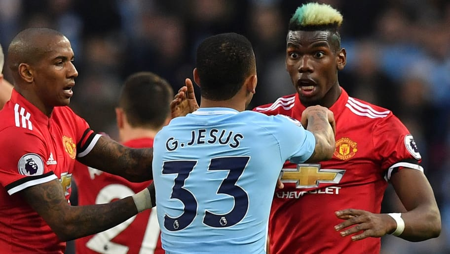 Manchester United's French midfielder Paul Pogba (R) clashes with Manchester City's Brazilian striker Gabriel Jesus after a foul on Manchester United's English midfielder Jesse Lingard by Manchester City's Brazilian midfielder Fernandinho during the English Premier League football match between Manchester City and Manchester United at the Etihad Stadium in Manchester, north west England, on April 7, 2018. / AFP PHOTO / Ben STANSALL / RESTRICTED TO EDITORIAL USE. No use with unauthorized audio, video, data, fixture lists, club/league logos or 'live' services. Online in-match use limited to 75 images, no video emulation. No use in betting, games or single club/league/player publications.  /         (Photo credit should read BEN STANSALL/AFP/Getty Images)