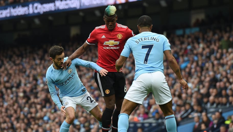 Manchester United's French midfielder Paul Pogba (C) vies with Manchester City's Portuguese midfielder Bernardo Silva (L) and Manchester City's English midfielder Raheem Sterling during the English Premier League football match between Manchester City and Manchester United at the Etihad Stadium in Manchester, north west England, on April 7, 2018. / AFP PHOTO / PAUL ELLIS / RESTRICTED TO EDITORIAL USE. No use with unauthorized audio, video, data, fixture lists, club/league logos or 'live' services. Online in-match use limited to 75 images, no video emulation. No use in betting, games or single club/league/player publications.  /         (Photo credit should read PAUL ELLIS/AFP/Getty Images)