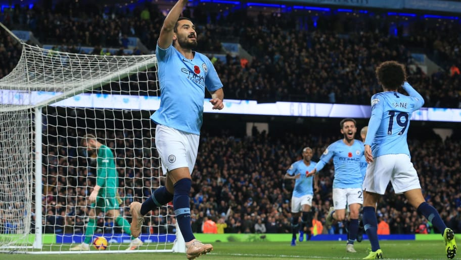 Manchester City's German midfielder Ilkay Gundogan celebrates after scoring their third goal during the English Premier League football match between Manchester City and Manchester United at the Etihad Stadium in Manchester, north west England, on November 11, 2018. (Photo by Lindsey PARNABY / AFP) / RESTRICTED TO EDITORIAL USE. No use with unauthorized audio, video, data, fixture lists, club/league logos or 'live' services. Online in-match use limited to 120 images. An additional 40 images may be used in extra time. No video emulation. Social media in-match use limited to 120 images. An additional 40 images may be used in extra time. No use in betting publications, games or single club/league/player publications. /         (Photo credit should read LINDSEY PARNABY/AFP/Getty Images)