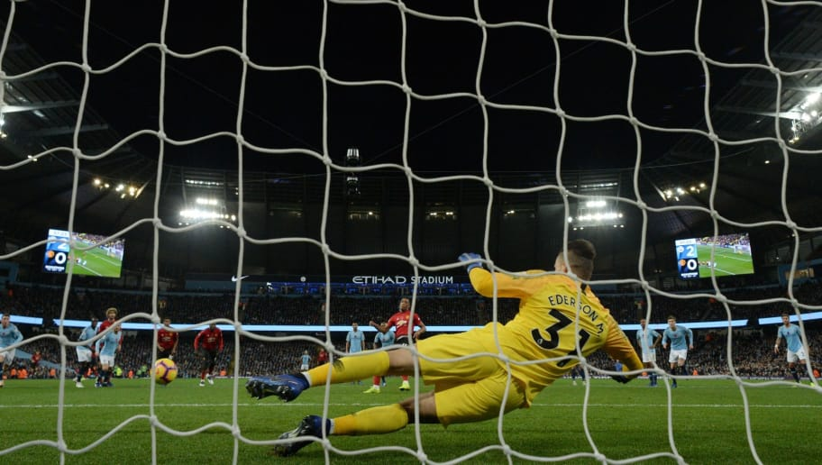 Manchester United's French striker Anthony Martial scores from the penalty spot past Manchester City's Brazilian goalkeeper Ederson during the English Premier League football match between Manchester City and Manchester United at the Etihad Stadium in Manchester, north west England, on November 11, 2018. (Photo by OLI SCARFF / AFP) / RESTRICTED TO EDITORIAL USE. No use with unauthorized audio, video, data, fixture lists, club/league logos or 'live' services. Online in-match use limited to 120 images. An additional 40 images may be used in extra time. No video emulation. Social media in-match use limited to 120 images. An additional 40 images may be used in extra time. No use in betting publications, games or single club/league/player publications. /         (Photo credit should read OLI SCARFF/AFP/Getty Images)