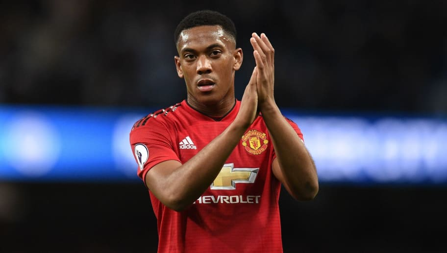 Manchester United's French striker Anthony Martial applauds fans after losing the English Premier League football match between Manchester City and Manchester United at the Etihad Stadium in Manchester, north west England, on November 11, 2018. (Photo by Oli SCARFF / AFP) / RESTRICTED TO EDITORIAL USE. No use with unauthorized audio, video, data, fixture lists, club/league logos or 'live' services. Online in-match use limited to 120 images. An additional 40 images may be used in extra time. No video emulation. Social media in-match use limited to 120 images. An additional 40 images may be used in extra time. No use in betting publications, games or single club/league/player publications. /         (Photo credit should read OLI SCARFF/AFP/Getty Images)