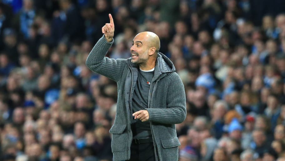 Manchester City's Spanish manager Pep Guardiola gestures during the English Premier League football match between Manchester City and Manchester United at the Etihad Stadium in Manchester, north west England, on November 11, 2018. (Photo by Lindsey PARNABY / AFP) / RESTRICTED TO EDITORIAL USE. No use with unauthorized audio, video, data, fixture lists, club/league logos or 'live' services. Online in-match use limited to 120 images. An additional 40 images may be used in extra time. No video emulation. Social media in-match use limited to 120 images. An additional 40 images may be used in extra time. No use in betting publications, games or single club/league/player publications. /         (Photo credit should read LINDSEY PARNABY/AFP/Getty Images)