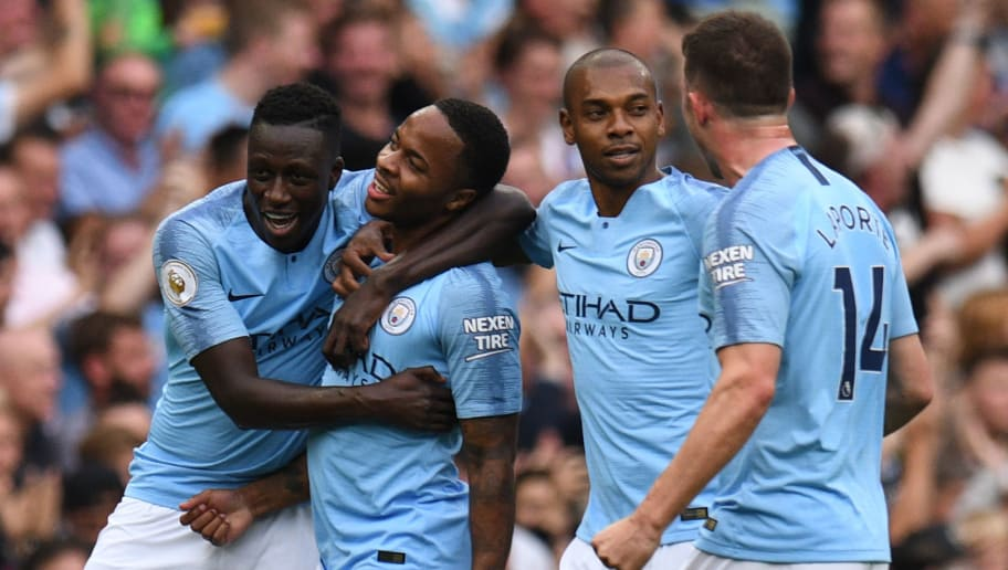Manchester City's English midfielder Raheem Sterling (2nd L) celebrates with teammates after scoring the opening goal of the English Premier League football match between Manchester City and Newcastle United at the Etihad Stadium in Manchester, north west England, on September 1, 2018. (Photo by Oli SCARFF / AFP) / RESTRICTED TO EDITORIAL USE. No use with unauthorized audio, video, data, fixture lists, club/league logos or 'live' services. Online in-match use limited to 120 images. An additional 40 images may be used in extra time. No video emulation. Social media in-match use limited to 120 images. An additional 40 images may be used in extra time. No use in betting publications, games or single club/league/player publications. /         (Photo credit should read OLI SCARFF/AFP/Getty Images)