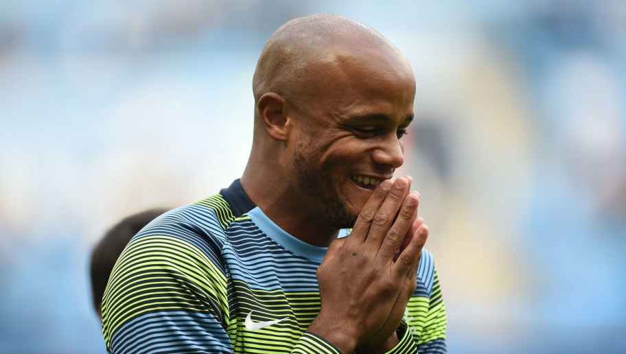 Manchester City's Belgian defender Vincent Kompany smiles as he warms up ahead of the English Premier League football match between Manchester City and Newcastle United at the Etihad Stadium in Manchester, north west England, on September 1, 2018. (Photo by Oli SCARFF / AFP) / RESTRICTED TO EDITORIAL USE. No use with unauthorized audio, video, data, fixture lists, club/league logos or 'live' services. Online in-match use limited to 120 images. An additional 40 images may be used in extra time. No video emulation. Social media in-match use limited to 120 images. An additional 40 images may be used in extra time. No use in betting publications, games or single club/league/player publications. /         (Photo credit should read OLI SCARFF/AFP/Getty Images)