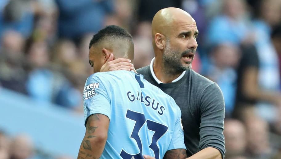 Manchester City's Spanish manager Pep Guardiola gestures to Manchester City's Brazilian striker Gabriel Jesus (L) as he's sunstituted during the English Premier League football match between Manchester City and Newcastle United at the Etihad Stadium in Manchester, north west England, on September 1, 2018. - Manchester City won the game 2-1. (Photo by Lindsey PARNABY / AFP) / RESTRICTED TO EDITORIAL USE. No use with unauthorized audio, video, data, fixture lists, club/league logos or 'live' services. Online in-match use limited to 120 images. An additional 40 images may be used in extra time. No video emulation. Social media in-match use limited to 120 images. An additional 40 images may be used in extra time. No use in betting publications, games or single club/league/player publications. /         (Photo credit should read LINDSEY PARNABY/AFP/Getty Images)