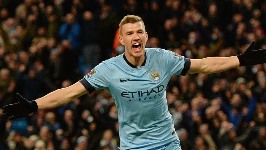 Manchester City's Bosnian striker Edin Dzeko celebrates after scoring his team's third goal during the English Premier League football match between Manchester City and Newcastle at the The Etihad Stadium in Manchester, north west England on February 21, 2015.  AFP PHOTO / OLI SCARFF  RESTRICTED TO EDITORIAL USE. NO USE WITH UNAUTHORIZED AUDIO, VIDEO, DATA, FIXTURE LISTS, CLUB/LEAGUE LOGOS OR 'LIVE' SERVICES. ONLINE IN-MATCH USE LIMITED TO 45 IMAGES, NO VIDEO EMULATION. NO USE IN BETTING, GAMES OR SINGLE CLUB/LEAGUE/PLAYER PUBLICATIONS.        (Photo credit should read OLI SCARFF/AFP/Getty Images)