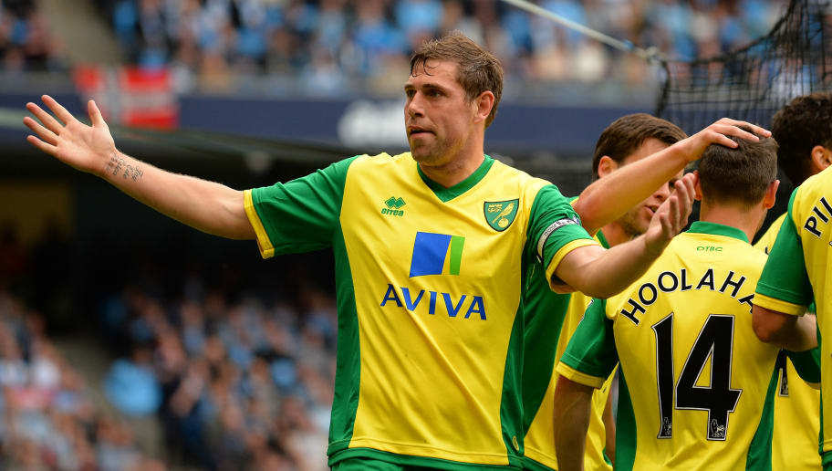 "Norwich City's English forward Grant Holt (L) celebrates after scoring his team's second goal during the English Premier League football match between Manchester City and Norwich City at the Etihad Stadium in Manchester, northwest England, on May 19, 2013.  AFP PHOTO / ANDREW YATES   RESTRICTED TO EDITORIAL USE. No use with unauthorized audio, video, data, fixture lists, club/league logos or ""live"" services. Online in-match use limited to 45 images, no video emulation. No use in betting, games or single club/league/player publications.        (Photo credit should read ANDREW YATES/AFP/Getty Images)"