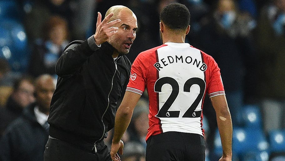 Manchester City's Spanish manager Pep Guardiola reacts as he talks with Southampton's English midfielder Nathan Redmond following the English Premier League football match between Manchester City and Southampton at the Etihad Stadium in Manchester, north west England, on November 29, 2017. Manchester City won the match 2-1. / AFP PHOTO / Oli SCARFF / RESTRICTED TO EDITORIAL USE. No use with unauthorized audio, video, data, fixture lists, club/league logos or 'live' services. Online in-match use limited to 75 images, no video emulation. No use in betting, games or single club/league/player publications.  /         (Photo credit should read OLI SCARFF/AFP/Getty Images)