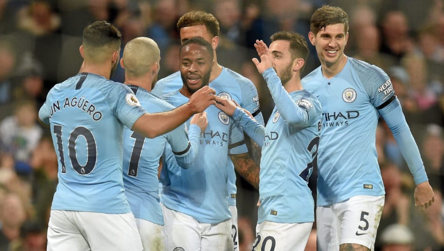 Manchester City's English midfielder Raheem Sterling (C) celebrates with teammates after scoring their fifth goal during the English Premier League football match between Manchester City and Southampton at the Etihad Stadium in Manchester, north west England, on November 4, 2018. (Photo by Oli SCARFF / AFP) / RESTRICTED TO EDITORIAL USE. No use with unauthorized audio, video, data, fixture lists, club/league logos or 'live' services. Online in-match use limited to 120 images. An additional 40 images may be used in extra time. No video emulation. Social media in-match use limited to 120 images. An additional 40 images may be used in extra time. No use in betting publications, games or single club/league/player publications. /         (Photo credit should read OLI SCARFF/AFP/Getty Images)