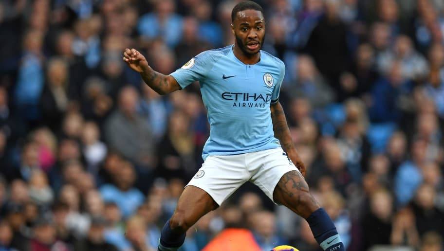 Manchester City's English midfielder Raheem Sterling looks to pass the ball during the English Premier League football match between Manchester City and Southampton at the Etihad Stadium in Manchester, north west England, on November 4, 2018. (Photo by Paul ELLIS / AFP) / RESTRICTED TO EDITORIAL USE. No use with unauthorized audio, video, data, fixture lists, club/league logos or 'live' services. Online in-match use limited to 120 images. An additional 40 images may be used in extra time. No video emulation. Social media in-match use limited to 120 images. An additional 40 images may be used in extra time. No use in betting publications, games or single club/league/player publications. /         (Photo credit should read PAUL ELLIS/AFP/Getty Images)
