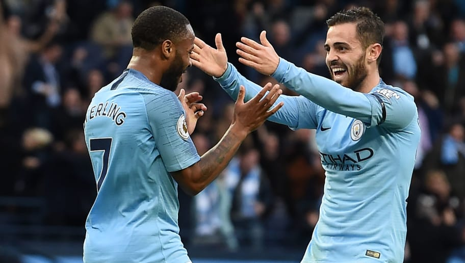Manchester City's English midfielder Raheem Sterling (L) celebrates with Manchester City's Portuguese midfielder Bernardo Silva (R) after scoring their fourth goal during the English Premier League football match between Manchester City and Southampton at the Etihad Stadium in Manchester, north west England, on November 4, 2018. (Photo by Paul ELLIS / AFP) / RESTRICTED TO EDITORIAL USE. No use with unauthorized audio, video, data, fixture lists, club/league logos or 'live' services. Online in-match use limited to 120 images. An additional 40 images may be used in extra time. No video emulation. Social media in-match use limited to 120 images. An additional 40 images may be used in extra time. No use in betting publications, games or single club/league/player publications. /         (Photo credit should read PAUL ELLIS/AFP/Getty Images)