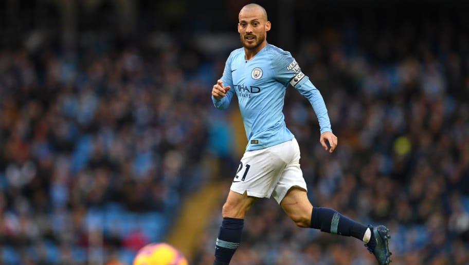 Manchester City's Spanish midfielder David Silva watches the ball during the English Premier League football match between Manchester City and Southampton at the Etihad Stadium in Manchester, north west England, on November 4, 2018. (Photo by Paul ELLIS / AFP) / RESTRICTED TO EDITORIAL USE. No use with unauthorized audio, video, data, fixture lists, club/league logos or 'live' services. Online in-match use limited to 120 images. An additional 40 images may be used in extra time. No video emulation. Social media in-match use limited to 120 images. An additional 40 images may be used in extra time. No use in betting publications, games or single club/league/player publications. /         (Photo credit should read PAUL ELLIS/AFP/Getty Images)