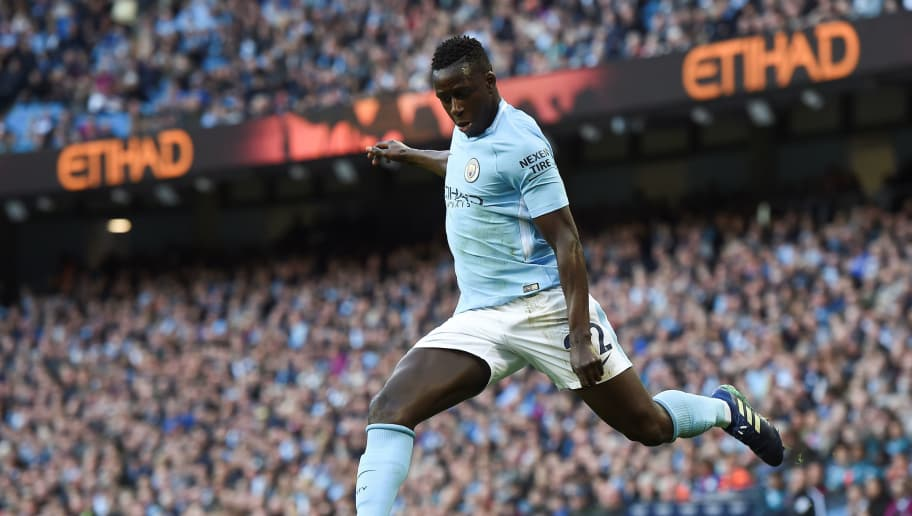 Manchester City's French defender Benjamin Mendy crosses the ball during the English Premier League football match between Manchester City and Swansea at the Etihad Stadium in Manchester, north west England, on April 22, 2018. (Photo by Paul ELLIS / AFP) / RESTRICTED TO EDITORIAL USE. No use with unauthorized audio, video, data, fixture lists, club/league logos or 'live' services. Online in-match use limited to 75 images, no video emulation. No use in betting, games or single club/league/player publications. /         (Photo credit should read PAUL ELLIS/AFP/Getty Images)