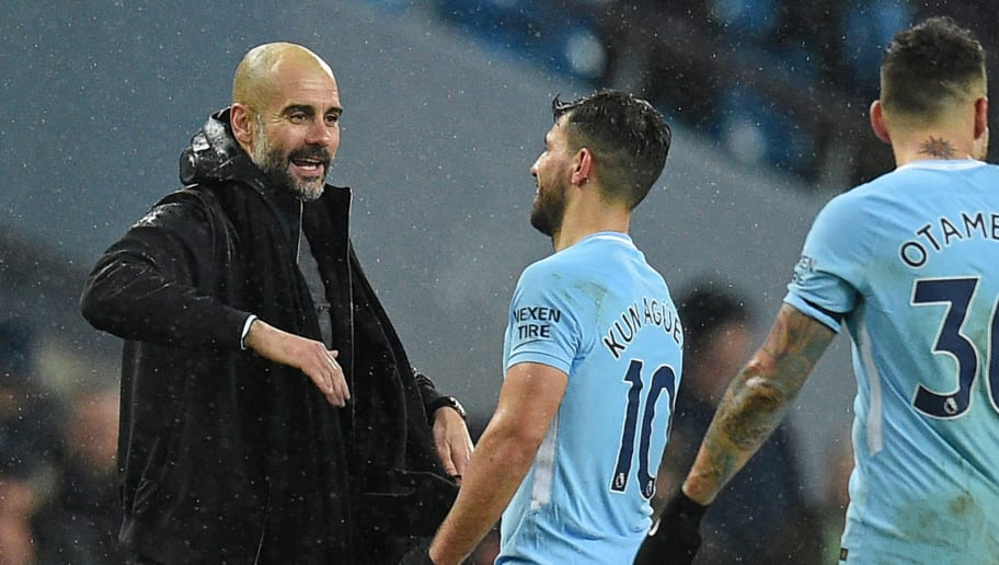 Manchester City's Spanish manager Pep Guardiola (L0 reacts with Manchester City's Argentinian striker Sergio Aguero after the English Premier League football match between Manchester City and West Bromwich Albion at the Etihad Stadium in Manchester, north west England, on January 31, 2018. Manchester City won the game 3-0. / AFP PHOTO / Oli SCARFF / RESTRICTED TO EDITORIAL USE. No use with unauthorized audio, video, data, fixture lists, club/league logos or 'live' services. Online in-match use limited to 75 images, no video emulation. No use in betting, games or single club/league/player publications.  /         (Photo credit should read OLI SCARFF/AFP/Getty Images)