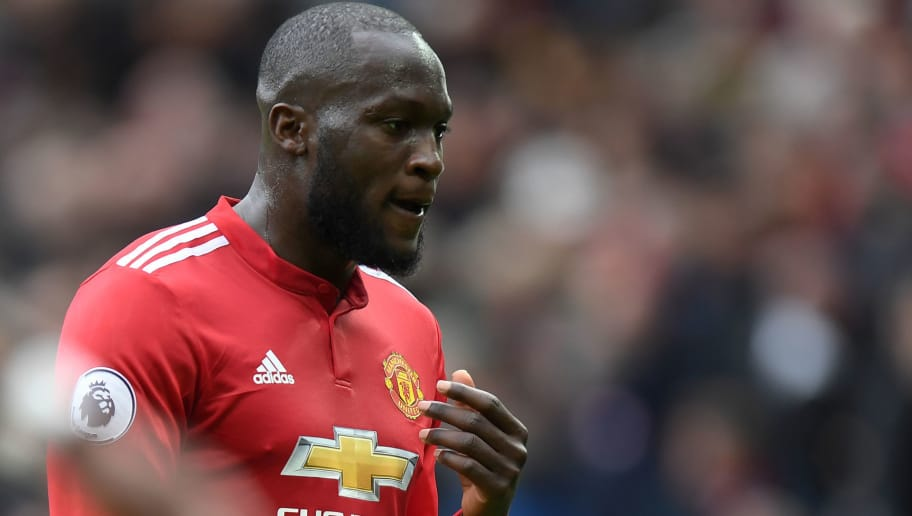 Manchester United's Belgian striker Romelu Lukaku gestures as he leaves the field at half time during the English Premier League football match between Manchester United and Arsenal at Old Trafford in Manchester, north west England, on April 29, 2018. (Photo by Paul ELLIS / AFP) / RESTRICTED TO EDITORIAL USE. No use with unauthorized audio, video, data, fixture lists, club/league logos or 'live' services. Online in-match use limited to 75 images, no video emulation. No use in betting, games or single club/league/player publications. /         (Photo credit should read PAUL ELLIS/AFP/Getty Images)