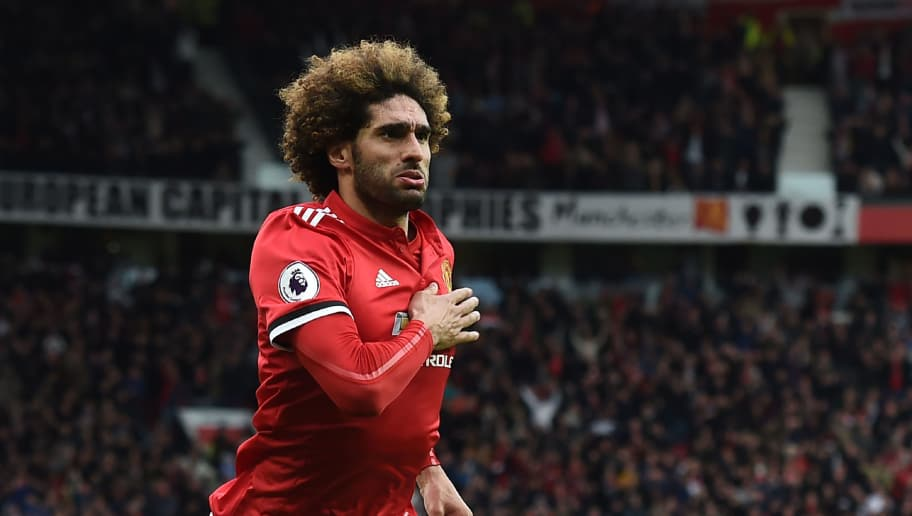 Manchester United's Belgian midfielder Marouane Fellaini celebrates after scoring their late second goal during the English Premier League football match between Manchester United and Arsenal at Old Trafford in Manchester, north west England, on April 29, 2018. - Manchester United won the game 2-1. (Photo by Paul ELLIS / AFP) / RESTRICTED TO EDITORIAL USE. No use with unauthorized audio, video, data, fixture lists, club/league logos or 'live' services. Online in-match use limited to 75 images, no video emulation. No use in betting, games or single club/league/player publications. /         (Photo credit should read PAUL ELLIS/AFP/Getty Images)