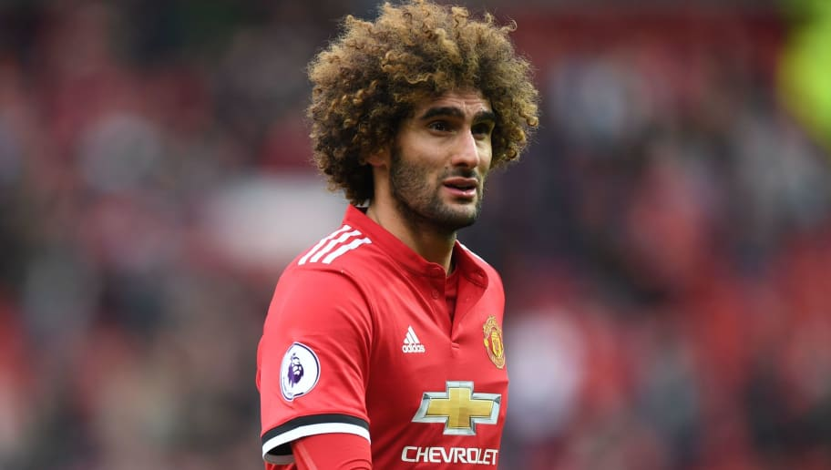 Manchester United's Belgian midfielder Marouane Fellaini leaves the pitch after the English Premier League football match between Manchester United and Arsenal at Old Trafford in Manchester, north west England, on April 29, 2018. - Manchester United won the game 2-1. (Photo by Paul ELLIS / AFP) / RESTRICTED TO EDITORIAL USE. No use with unauthorized audio, video, data, fixture lists, club/league logos or 'live' services. Online in-match use limited to 75 images, no video emulation. No use in betting, games or single club/league/player publications. /         (Photo credit should read PAUL ELLIS/AFP/Getty Images)