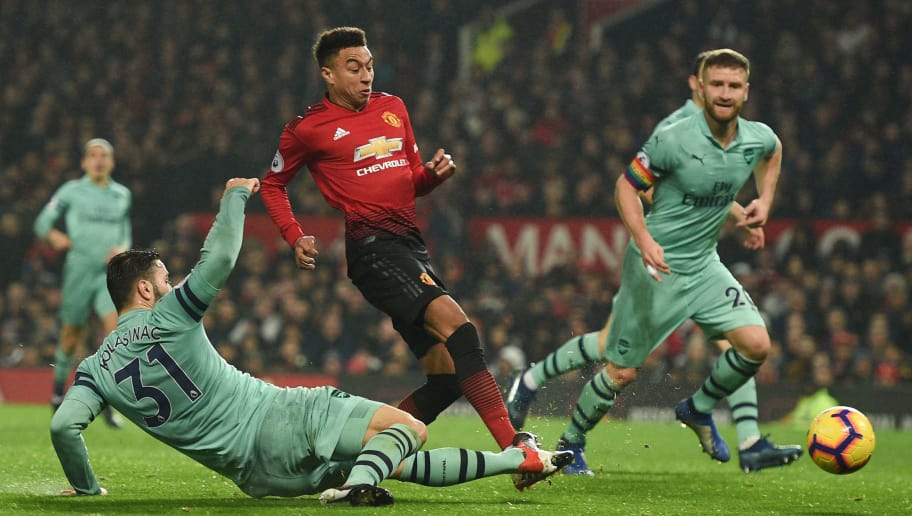 Manchester United's English midfielder Jesse Lingard (C) scores their second goal to equalise 2-2 during the English Premier League football match between Manchester United and Arsenal at Old Trafford in Manchester, north west England, on December 5, 2018. (Photo by Oli SCARFF / AFP) / RESTRICTED TO EDITORIAL USE. No use with unauthorized audio, video, data, fixture lists, club/league logos or 'live' services. Online in-match use limited to 120 images. An additional 40 images may be used in extra time. No video emulation. Social media in-match use limited to 120 images. An additional 40 images may be used in extra time. No use in betting publications, games or single club/league/player publications. /         (Photo credit should read OLI SCARFF/AFP/Getty Images)