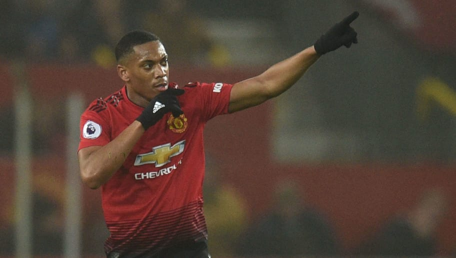 Manchester United's French striker Anthony Martial celebrates scoring their first goal to equalise 1-1 during the English Premier League football match between Manchester United and Arsenal at Old Trafford in Manchester, north west England, on December 5, 2018. (Photo by Oli SCARFF / AFP) / RESTRICTED TO EDITORIAL USE. No use with unauthorized audio, video, data, fixture lists, club/league logos or 'live' services. Online in-match use limited to 120 images. An additional 40 images may be used in extra time. No video emulation. Social media in-match use limited to 120 images. An additional 40 images may be used in extra time. No use in betting publications, games or single club/league/player publications. /         (Photo credit should read OLI SCARFF/AFP/Getty Images)