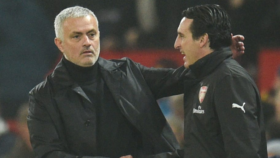 Manchester United's Portuguese manager Jose Mourinho (L) shakes hands with Arsenal's Spanish head coach Unai Emery (R) at the end of the English Premier League football match between Manchester United and Arsenal at Old Trafford in Manchester, north west England, on December 5, 2018. (Photo by Oli SCARFF / AFP) / RESTRICTED TO EDITORIAL USE. No use with unauthorized audio, video, data, fixture lists, club/league logos or 'live' services. Online in-match use limited to 120 images. An additional 40 images may be used in extra time. No video emulation. Social media in-match use limited to 120 images. An additional 40 images may be used in extra time. No use in betting publications, games or single club/league/player publications. /         (Photo credit should read OLI SCARFF/AFP/Getty Images)