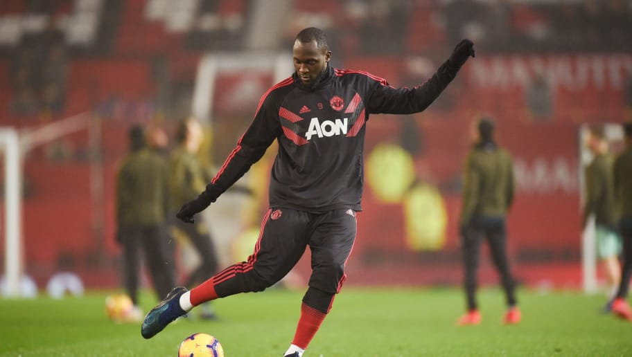 Manchester United's Belgian striker Romelu Lukaku warms up for the English Premier League football match between Manchester United and Arsenal at Old Trafford in Manchester, north west England, on December 5, 2018. (Photo by Oli SCARFF / AFP) / RESTRICTED TO EDITORIAL USE. No use with unauthorized audio, video, data, fixture lists, club/league logos or 'live' services. Online in-match use limited to 120 images. An additional 40 images may be used in extra time. No video emulation. Social media in-match use limited to 120 images. An additional 40 images may be used in extra time. No use in betting publications, games or single club/league/player publications. /         (Photo credit should read OLI SCARFF/AFP/Getty Images)