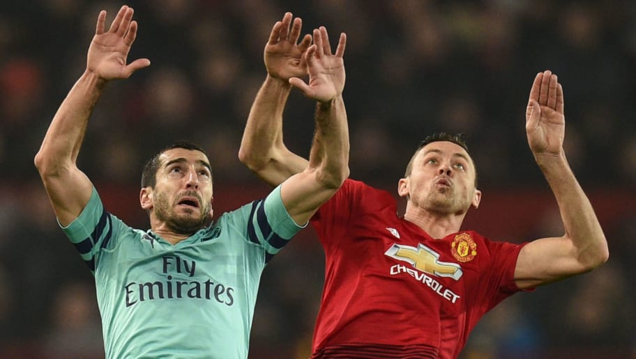 Arsenal's Armenian midfielder Henrikh Mkhitaryan (L) jumps against Manchester United's Serbian midfielder Nemanja Matic (R) during the English Premier League football match between Manchester United and Arsenal at Old Trafford in Manchester, north west England, on December 5, 2018. (Photo by Oli SCARFF / AFP) / RESTRICTED TO EDITORIAL USE. No use with unauthorized audio, video, data, fixture lists, club/league logos or 'live' services. Online in-match use limited to 120 images. An additional 40 images may be used in extra time. No video emulation. Social media in-match use limited to 120 images. An additional 40 images may be used in extra time. No use in betting publications, games or single club/league/player publications. /         (Photo credit should read OLI SCARFF/AFP/Getty Images)