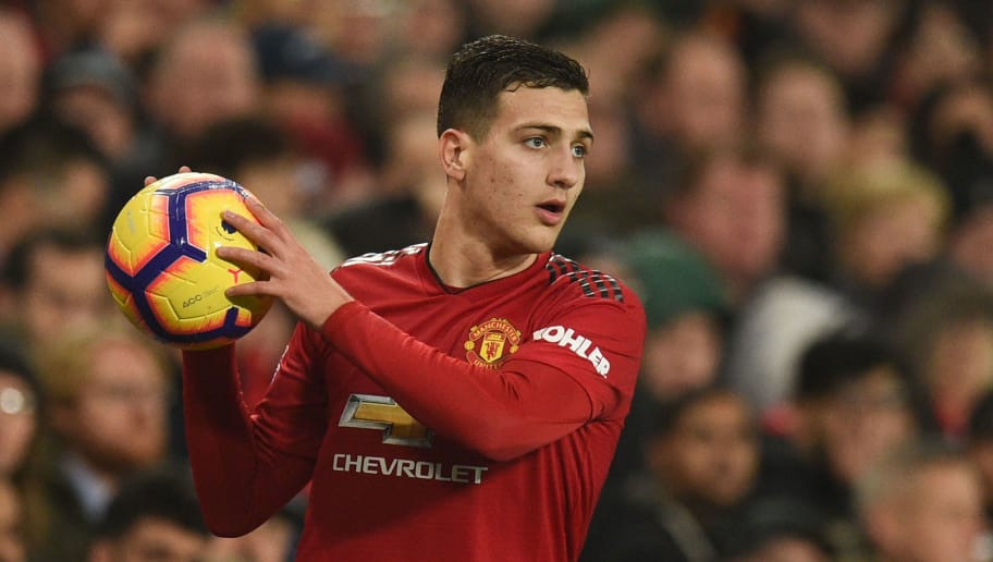 Manchester United's Portuguese defender Diogo Dalot prepares to take a throw in during the English Premier League football match between Manchester United and Arsenal at Old Trafford in Manchester, north west England, on December 5, 2018. (Photo by Oli SCARFF / AFP) / RESTRICTED TO EDITORIAL USE. No use with unauthorized audio, video, data, fixture lists, club/league logos or 'live' services. Online in-match use limited to 120 images. An additional 40 images may be used in extra time. No video emulation. Social media in-match use limited to 120 images. An additional 40 images may be used in extra time. No use in betting publications, games or single club/league/player publications. /         (Photo credit should read OLI SCARFF/AFP/Getty Images)