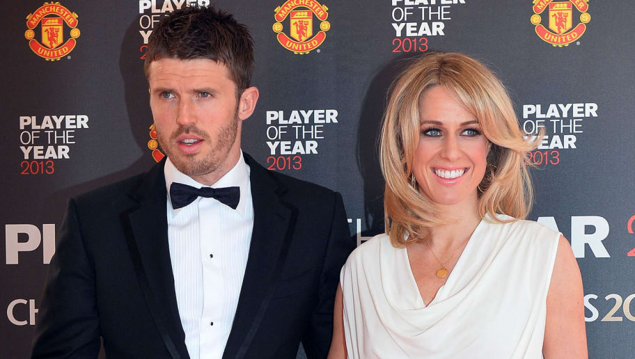 Manchester United's English midfielder Michael Carrick (L) arrives for their Player of the Year awards at Old Trafford, Manchester, northwest England on May 15, 2013 AFP PHOTO / PAUL ELLIS        (Photo credit should read PAUL ELLIS/AFP/Getty Images)