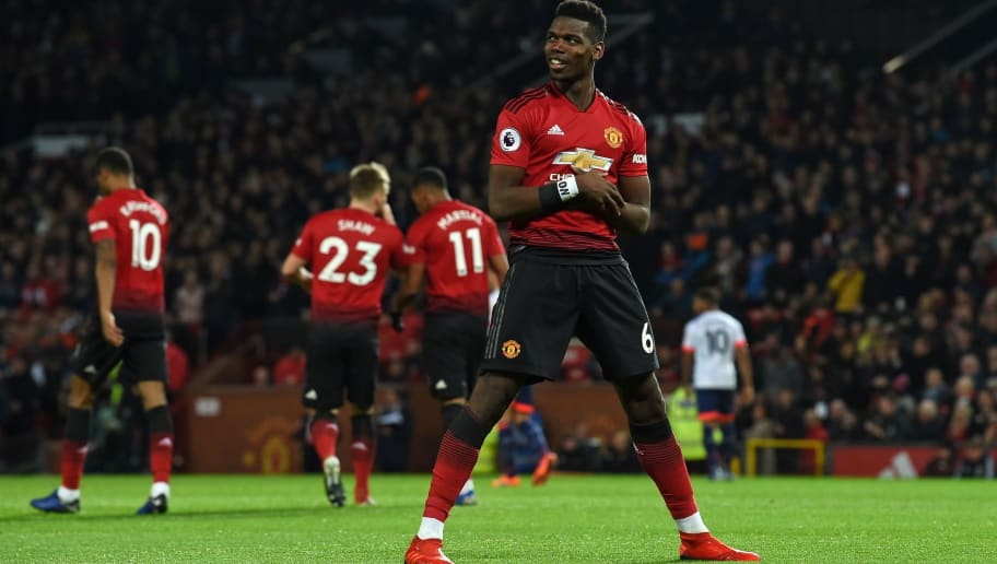 Manchester United's French midfielder Paul Pogba (C) celebrates after scoring the opening goal of the English Premier League football match between Manchester United and Bournemouth at Old Trafford in Manchester, north west England, on December 30, 2018. (Photo by Paul ELLIS / AFP) / RESTRICTED TO EDITORIAL USE. No use with unauthorized audio, video, data, fixture lists, club/league logos or 'live' services. Online in-match use limited to 120 images. An additional 40 images may be used in extra time. No video emulation. Social media in-match use limited to 120 images. An additional 40 images may be used in extra time. No use in betting publications, games or single club/league/player publications. /         (Photo credit should read PAUL ELLIS/AFP/Getty Images)