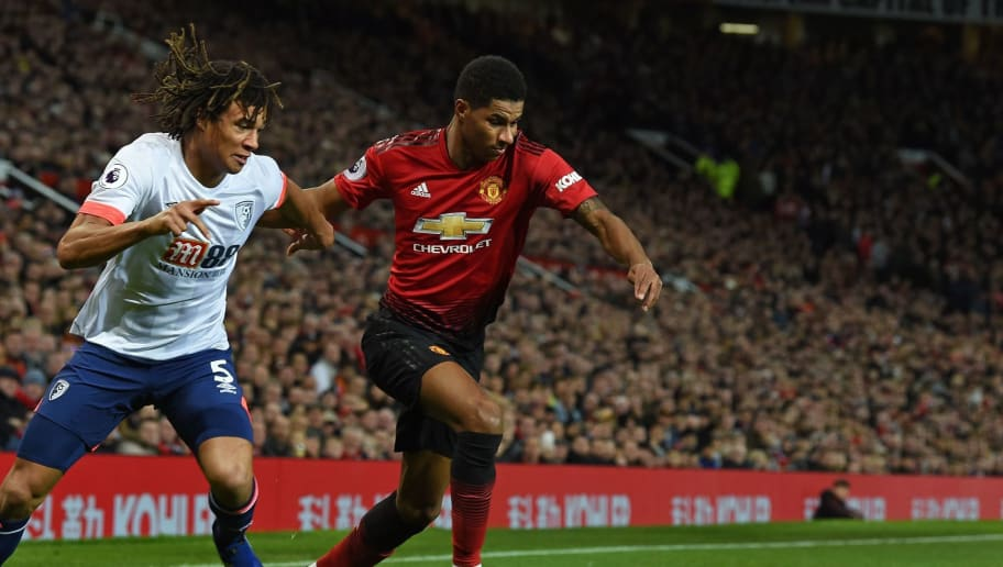 Manchester United's English striker Marcus Rashford (R) vies with Bournemouth's Dutch defender Nathan Ake (L) during the English Premier League football match between Manchester United and Bournemouth at Old Trafford in Manchester, north west England, on December 30, 2018. (Photo by Paul ELLIS / AFP) / RESTRICTED TO EDITORIAL USE. No use with unauthorized audio, video, data, fixture lists, club/league logos or 'live' services. Online in-match use limited to 120 images. An additional 40 images may be used in extra time. No video emulation. Social media in-match use limited to 120 images. An additional 40 images may be used in extra time. No use in betting publications, games or single club/league/player publications. /         (Photo credit should read PAUL ELLIS/AFP/Getty Images)