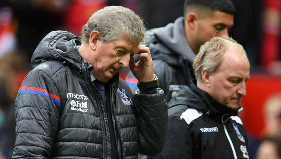 Crystal Palace's English manager Roy Hodgson (L) walks with assistant manager Ray Lewington during the English Premier League football match between Manchester United and Crystal Palace at Old Trafford in Manchester, north west England, on September 30, 2017. / AFP PHOTO / Paul ELLIS / RESTRICTED TO EDITORIAL USE. No use with unauthorized audio, video, data, fixture lists, club/league logos or 'live' services. Online in-match use limited to 75 images, no video emulation. No use in betting, games or single club/league/player publications.  /         (Photo credit should read PAUL ELLIS/AFP/Getty Images)