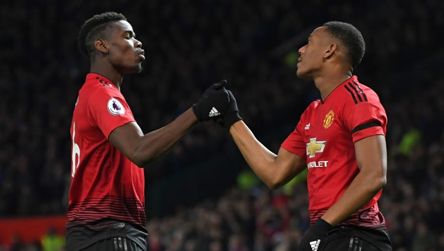 Manchester United's French striker Anthony Martial celebrates with Manchester United's French midfielder Paul Pogba (L) after scoring their second goal during the English Premier League football match between Manchester United and Everton at Old Trafford in Manchester, north west England, on October 28, 2018. (Photo by Paul ELLIS / AFP) / RESTRICTED TO EDITORIAL USE. No use with unauthorized audio, video, data, fixture lists, club/league logos or 'live' services. Online in-match use limited to 120 images. An additional 40 images may be used in extra time. No video emulation. Social media in-match use limited to 120 images. An additional 40 images may be used in extra time. No use in betting publications, games or single club/league/player publications. /         (Photo credit should read PAUL ELLIS/AFP/Getty Images)