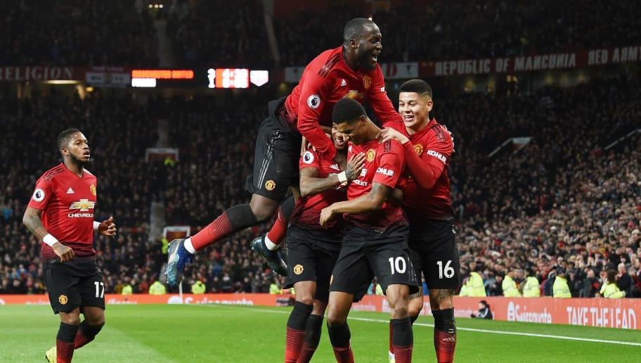 Manchester United's English striker Marcus Rashford celebrates with teammates after scoring their fourth goal during the English Premier League football match between Manchester United and Fulham at Old Trafford in Manchester, north west England, on December 8, 2018. (Photo by Paul ELLIS / AFP) / RESTRICTED TO EDITORIAL USE. No use with unauthorized audio, video, data, fixture lists, club/league logos or 'live' services. Online in-match use limited to 120 images. An additional 40 images may be used in extra time. No video emulation. Social media in-match use limited to 120 images. An additional 40 images may be used in extra time. No use in betting publications, games or single club/league/player publications. /         (Photo credit should read PAUL ELLIS/AFP/Getty Images)