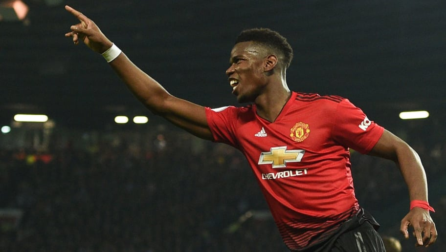 Manchester United's French midfielder Paul Pogba celebrates scoring their second goal during the English Premier League football match between Manchester United and Huddersfield Town at Old Trafford in Manchester, north west England, on December 26, 2018. (Photo by Oli SCARFF / AFP) / RESTRICTED TO EDITORIAL USE. No use with unauthorized audio, video, data, fixture lists, club/league logos or 'live' services. Online in-match use limited to 120 images. An additional 40 images may be used in extra time. No video emulation. Social media in-match use limited to 120 images. An additional 40 images may be used in extra time. No use in betting publications, games or single club/league/player publications. /         (Photo credit should read OLI SCARFF/AFP/Getty Images)