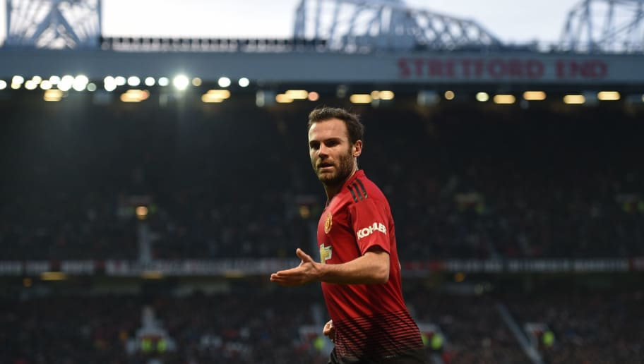 Manchester United's Spanish midfielder Juan Mata plays during the English Premier League football match between Manchester United and Huddersfield Town at Old Trafford in Manchester, north west England, on December 26, 2018. (Photo by Oli SCARFF / AFP) / RESTRICTED TO EDITORIAL USE. No use with unauthorized audio, video, data, fixture lists, club/league logos or 'live' services. Online in-match use limited to 120 images. An additional 40 images may be used in extra time. No video emulation. Social media in-match use limited to 120 images. An additional 40 images may be used in extra time. No use in betting publications, games or single club/league/player publications. /         (Photo credit should read OLI SCARFF/AFP/Getty Images)