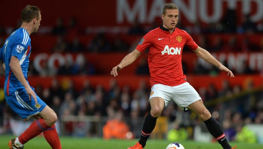 Manchester United's Serbian defender Nemanja Vidic controls the ball during the English Premier League football match between Manchester United and Hull City at Old Trafford in Manchester, northwest England on May 6, 2014. The Premier League fixture against Hull was the final time club captain Vidic, 32, turned out in front of the Old Trafford faithful as a United player, with the Serbia centre-back joining Inter Milan after the end of the season. Manchester United won the game 3-1. AFP PHOTO / PAUL ELLIS  RESTRICTED TO EDITORIAL USE. No use with unauthorized audio, video, data, fixture lists, club/league logos or live services. Online in-match use limited to 45 images, no video emulation. No use in betting, games or single club/league/player publications.        (Photo credit should read PAUL ELLIS/AFP/Getty Images)