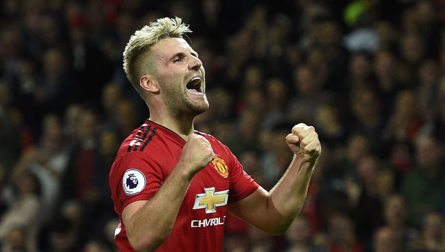 Manchester United's English defender Luke Shaw celebrates scoring the team's second goal during the English Premier League football match between Manchester United and Leicester City at Old Trafford in Manchester, north west England, on August 10, 2018. (Photo by Oli SCARFF / AFP) / RESTRICTED TO EDITORIAL USE. No use with unauthorized audio, video, data, fixture lists, club/league logos or 'live' services. Online in-match use limited to 120 images. An additional 40 images may be used in extra time. No video emulation. Social media in-match use limited to 120 images. An additional 40 images may be used in extra time. No use in betting publications, games or single club/league/player publications /         (Photo credit should read OLI SCARFF/AFP/Getty Images)
