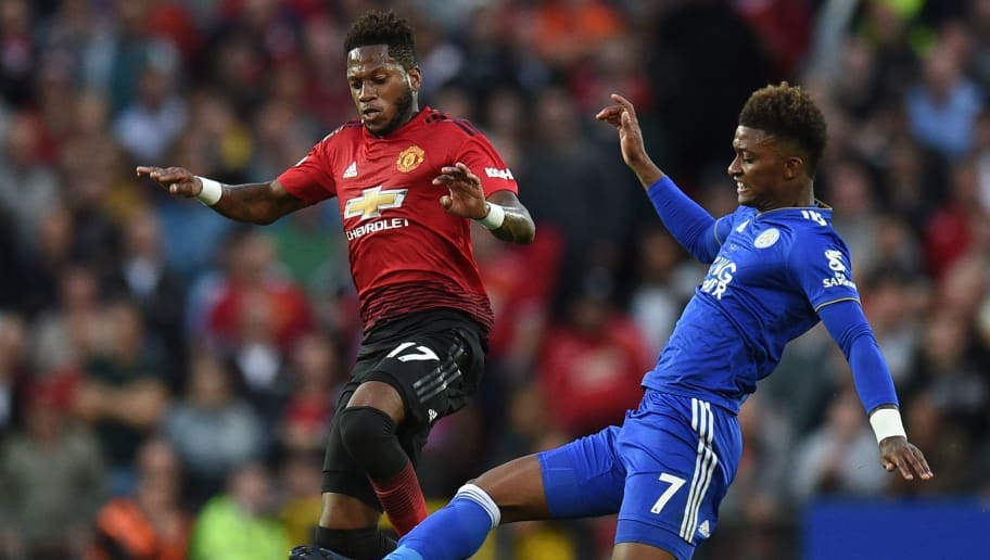 Manchester United's Brazilian midfielder Fred (L) vies with Leicester City's English midfielder Demarai Gray during the English Premier League football match between Manchester United and Leicester City at Old Trafford in Manchester, north west England, on August 10, 2018. (Photo by Oli SCARFF / AFP) / RESTRICTED TO EDITORIAL USE. No use with unauthorized audio, video, data, fixture lists, club/league logos or 'live' services. Online in-match use limited to 120 images. An additional 40 images may be used in extra time. No video emulation. Social media in-match use limited to 120 images. An additional 40 images may be used in extra time. No use in betting publications, games or single club/league/player publications /         (Photo credit should read OLI SCARFF/AFP/Getty Images)
