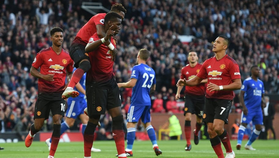 Manchester United's French midfielder Paul Pogba (C) with Manchester United's Brazilian midfielder Fred (2L) and Manchester United's Chilean striker Alexis Sanchez (R) after scoring the opening penalty during the English Premier League football match between Manchester United and Leicester City at Old Trafford in Manchester, north west England, on August 10, 2018. (Photo by Oli SCARFF / AFP) / RESTRICTED TO EDITORIAL USE. No use with unauthorized audio, video, data, fixture lists, club/league logos or 'live' services. Online in-match use limited to 120 images. An additional 40 images may be used in extra time. No video emulation. Social media in-match use limited to 120 images. An additional 40 images may be used in extra time. No use in betting publications, games or single club/league/player publications. /         (Photo credit should read OLI SCARFF/AFP/Getty Images)