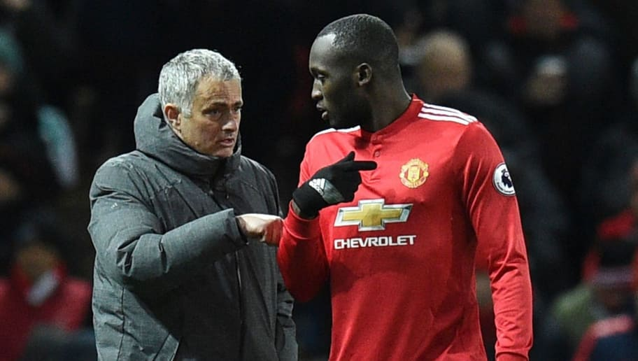 Manchester United's Portuguese manager Jose Mourinho (L) talks with Manchester United's Belgian striker Romelu Lukaku (R) during half-times during the English Premier League football match between Manchester United and Manchester City at Old Trafford in Manchester, north west England, on December 10, 2017. / AFP PHOTO / Oli SCARFF / RESTRICTED TO EDITORIAL USE. No use with unauthorized audio, video, data, fixture lists, club/league logos or 'live' services. Online in-match use limited to 75 images, no video emulation. No use in betting, games or single club/league/player publications.  /         (Photo credit should read OLI SCARFF/AFP/Getty Images)