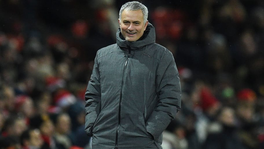 Manchester United's Portuguese manager Jose Mourinho laughs on the thouchline during the English Premier League football match between Manchester United and Manchester City at Old Trafford in Manchester, north west England, on December 10, 2017. / AFP PHOTO / Oli SCARFF / RESTRICTED TO EDITORIAL USE. No use with unauthorized audio, video, data, fixture lists, club/league logos or 'live' services. Online in-match use limited to 75 images, no video emulation. No use in betting, games or single club/league/player publications.  /         (Photo credit should read OLI SCARFF/AFP/Getty Images)