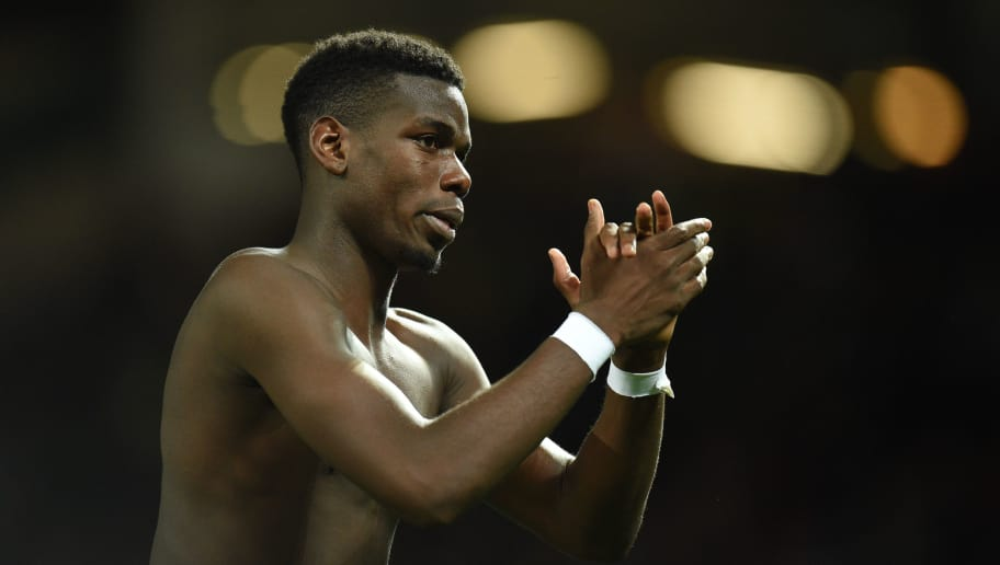 Manchester United's French midfielder Paul Pogba gestures after the English Premier League football match between Manchester United and Newcastle at Old Trafford in Manchester, north west England, on October 6, 2018. (Photo by Oli SCARFF / AFP) / RESTRICTED TO EDITORIAL USE. No use with unauthorized audio, video, data, fixture lists, club/league logos or 'live' services. Online in-match use limited to 120 images. An additional 40 images may be used in extra time. No video emulation. Social media in-match use limited to 120 images. An additional 40 images may be used in extra time. No use in betting publications, games or single club/league/player publications. /         (Photo credit should read OLI SCARFF/AFP/Getty Images)