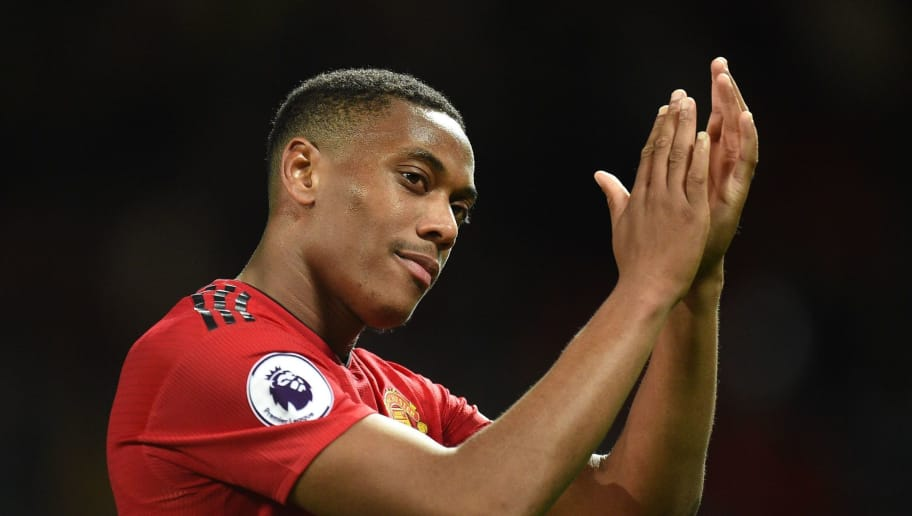 Manchester United's French striker Anthony Martial gestures after the English Premier League football match between Manchester United and Newcastle at Old Trafford in Manchester, north west England, on October 6, 2018. (Photo by Oli SCARFF / AFP) / RESTRICTED TO EDITORIAL USE. No use with unauthorized audio, video, data, fixture lists, club/league logos or 'live' services. Online in-match use limited to 120 images. An additional 40 images may be used in extra time. No video emulation. Social media in-match use limited to 120 images. An additional 40 images may be used in extra time. No use in betting publications, games or single club/league/player publications. /         (Photo credit should read OLI SCARFF/AFP/Getty Images)