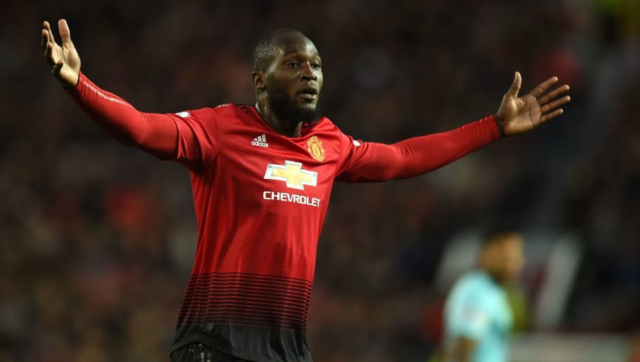 Manchester United's Belgian striker Romelu Lukaku gestures during the English Premier League football match between Manchester United and Newcastle at Old Trafford in Manchester, north west England, on October 6, 2018. (Photo by Oli SCARFF / AFP) / RESTRICTED TO EDITORIAL USE. No use with unauthorized audio, video, data, fixture lists, club/league logos or 'live' services. Online in-match use limited to 120 images. An additional 40 images may be used in extra time. No video emulation. Social media in-match use limited to 120 images. An additional 40 images may be used in extra time. No use in betting publications, games or single club/league/player publications. /         (Photo credit should read OLI SCARFF/AFP/Getty Images)