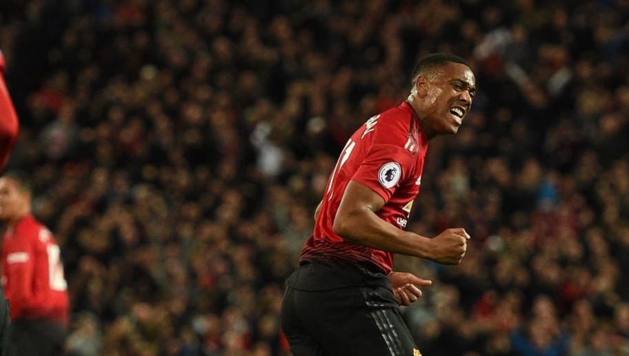 Manchester United's French striker Anthony Martial (R) celebrates after scoring the team's second goal during the English Premier League football match between Manchester United and Newcastle at Old Trafford in Manchester, north west England, on October 6, 2018. (Photo by Oli SCARFF / AFP) / RESTRICTED TO EDITORIAL USE. No use with unauthorized audio, video, data, fixture lists, club/league logos or 'live' services. Online in-match use limited to 120 images. An additional 40 images may be used in extra time. No video emulation. Social media in-match use limited to 120 images. An additional 40 images may be used in extra time. No use in betting publications, games or single club/league/player publications. /         (Photo credit should read OLI SCARFF/AFP/Getty Images)
