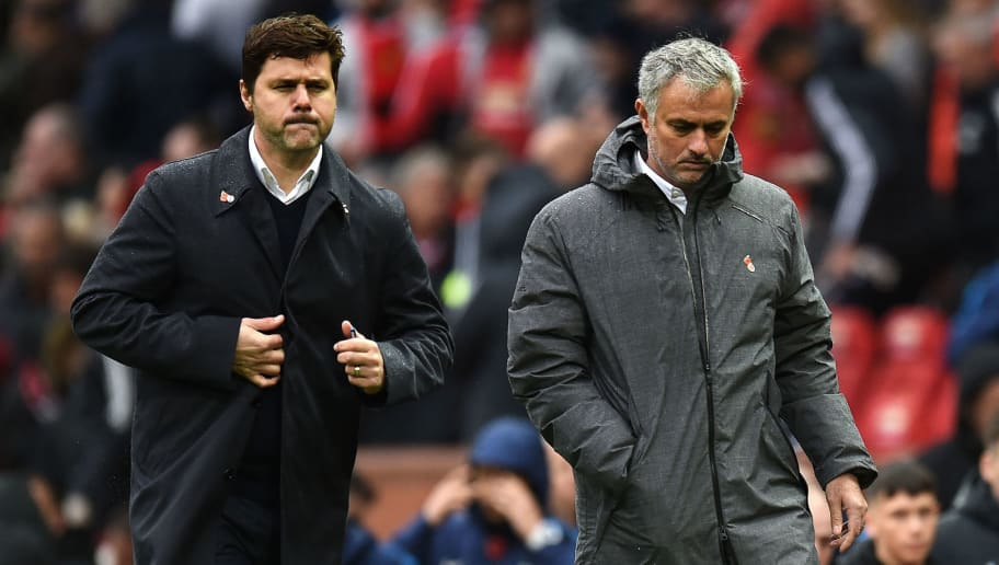Tottenham Hotspur's Argentinian head coach Mauricio Pochettino (L) and Manchester United's Portuguese manager Jose Mourinho (R) walk off at half time in the English Premier League football match between Manchester United and Tottenham Hotspur at Old Trafford in Manchester, north west England, on October 28, 2017. / AFP PHOTO / Oli SCARFF / RESTRICTED TO EDITORIAL USE. No use with unauthorized audio, video, data, fixture lists, club/league logos or 'live' services. Online in-match use limited to 75 images, no video emulation. No use in betting, games or single club/league/player publications.  /         (Photo credit should read OLI SCARFF/AFP/Getty Images)