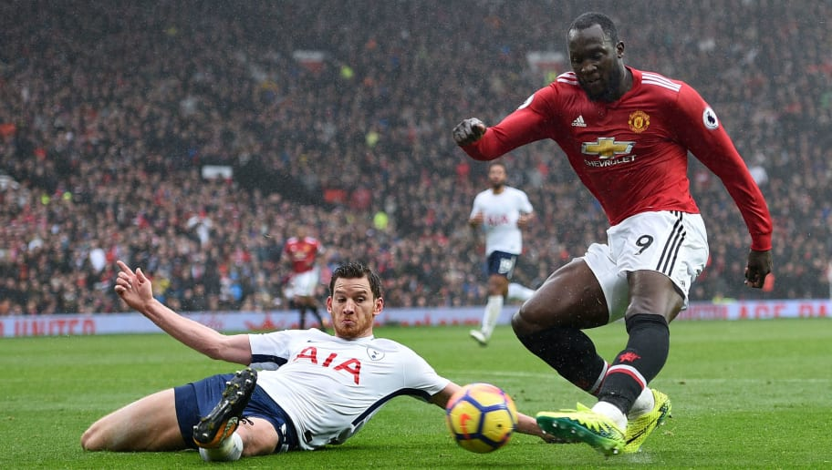 Manchester United's Belgian striker Romelu Lukaku (R) has an unsuccessful shot during the English Premier League football match between Manchester United and Tottenham Hotspur at Old Trafford in Manchester, north west England, on October 28, 2017. / AFP PHOTO / Oli SCARFF / RESTRICTED TO EDITORIAL USE. No use with unauthorized audio, video, data, fixture lists, club/league logos or 'live' services. Online in-match use limited to 75 images, no video emulation. No use in betting, games or single club/league/player publications.  /         (Photo credit should read OLI SCARFF/AFP/Getty Images)