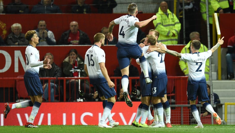 Tottenham Hotspur's Brazilian midfielder Lucas Moura (C) celebrates with team-mates after scoring their second goal during the English Premier League football match between Manchester United and Tottenham Hotspur at Old Trafford in Manchester, north west England, on August 27, 2018. (Photo by Oli SCARFF / AFP) / RESTRICTED TO EDITORIAL USE. No use with unauthorized audio, video, data, fixture lists, club/league logos or 'live' services. Online in-match use limited to 120 images. An additional 40 images may be used in extra time. No video emulation. Social media in-match use limited to 120 images. An additional 40 images may be used in extra time. No use in betting publications, games or single club/league/player publications. /         (Photo credit should read OLI SCARFF/AFP/Getty Images)
