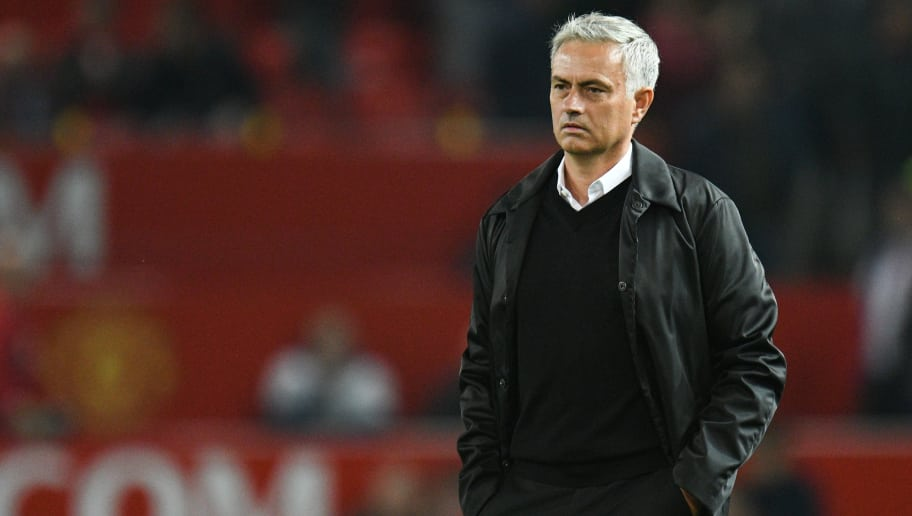 Manchester United's Portuguese manager Jose Mourinho stands on the pitch after the final whistle in the English Premier League football match between Manchester United and Tottenham Hotspur at Old Trafford in Manchester, north west England, on August 27, 2018. (Photo by Oli SCARFF / AFP) / RESTRICTED TO EDITORIAL USE. No use with unauthorized audio, video, data, fixture lists, club/league logos or 'live' services. Online in-match use limited to 120 images. An additional 40 images may be used in extra time. No video emulation. Social media in-match use limited to 120 images. An additional 40 images may be used in extra time. No use in betting publications, games or single club/league/player publications. /         (Photo credit should read OLI SCARFF/AFP/Getty Images)